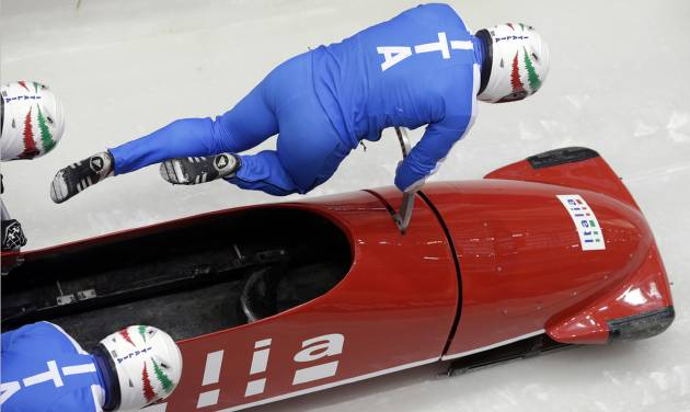 The team from Italy ITA-1, piloted by Simone Bertazzo, start a run during the men's four-man bobsled training at the 2014 Winter Olympics, Wednesday, Feb. 19, 2014, in Krasnaya Polyana, Russia. (AP Photo/Michael Sohn)