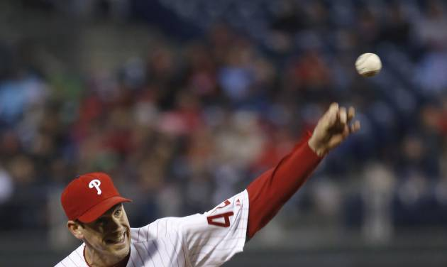 Philadelphia Phillies' Cliff Lee pitches during the third inning of a baseball game against the Atlanta Braves, Wednesday, April 16, 2014, in Philadelphia. (AP Photo/Matt Slocum)