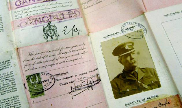"""This May 13, 2004 file photo shows Sir Arthur Conan Doyle's passport dating from World War I on display at Christie's auction house in London. The passport and some 3,000 other items were among Doyle's lost papers that were found in a London law firm's archive where they were stored and forgotten after they were taken from Doyle's writing desk in 1930, following his death. Arthur Conan Doyle met with troops in the spring of 1916 and completed his work """"A Visit To Three Fronts"""" over the summer. (AP Photo/Alastair Grant, File)"""