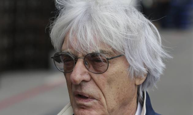 """FILE - In this Nov. 14, 2013 file picture  President and CEO of Formula One Management Bernie Ecclestone arrives at the Circuit of the Americas for the Formula One U.S. Grand Prix auto race, in Austin, Texas.  A German court says Formula One boss Bernie Ecclestone will go on trial on bribery charges. The Munich state court said Thursday Jan. 16, 2014  that it has decided to send to trial the indictment against the 83-year-old Ecclestone. He faces charges of bribery and incitement to breach of trust connected to the alleged payment of a US $45 million bribe to a German banker. Proceedings are currently expected to start at the end of April. The banker, Gerhard Gribkowsky, already has been convicted of taking the payment from Ecclestone in connection with the sale of a stake in F1. Ecclestone has insisted that he did """"nothing illegal.""""  (AP Photo/Darron Cummings, File)"""