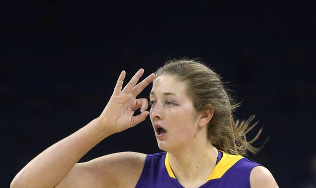 LSU forward Theresa Plaisance gestures after hitting a 3-point basket against Tennessee during the first half of an NCAA college basketball game in the quarterfinals of the Southeastern Conference women's tournament, Friday, March 7, 2014, in Duluth, Ga. (AP Photo/Jason Getz)