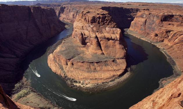 FILE - In this Wednesday, March 5, 2008 file photo, water levels at the Colorado River's Horseshoe Bend begin to rise along the beaches just hours after the Glen Canyon Dam jet tubes began releasing water, in Page, Ariz. Drought, climate change and an increasing population in the West are pushing the Colorado River basin toward deep trouble in the coming decades, scientists say. (AP Photo/Matt York)