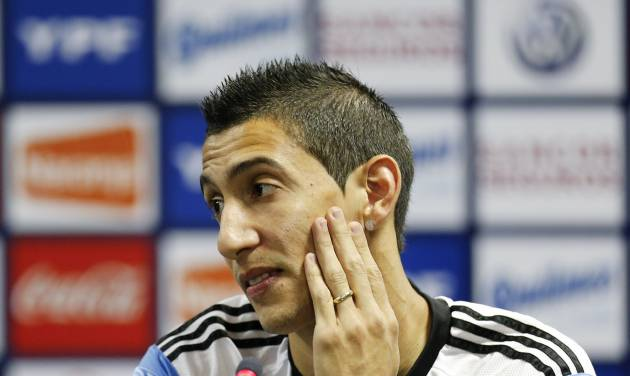 Argentina's Angel di Maria gestures during a news conference in Vespesiano, near Belo Horizonte, Brazil, Sunday, June 22, 2014.  Argentina plays in group F of the 2014 soccer World Cup. (AP Photo/Victor R. Caivano)