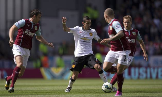 Manchester United's Angel Di Maria, center, attempts to beat the Burnley defence during their English Premier League soccer match at Turf Moor Stadium, Burnley, England, Saturday Aug. 30, 2014. (AP Photo/Jon Super)