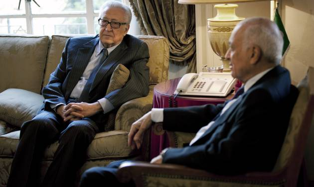 Arab League Secretary-General Nabil Elaraby, right, meets with U.N.-Arab League envoy to Syria Lakhdar Brahimi at the Arab League headquarters, in Cairo, Egypt, Sunday, Feb. 17, 2013. Brahimi, and Elaraby threw their weight behind the call for a dialogue to resolve the Syrian conflict made by Moaz al-Khatib, president of the opposition coalition. The rise of Islamic fundamentalists among the rebels makes many among Syria's minorities — including Alawites, Shiites, Christians, Armenians and others — fear that a rebel victory could leave them with no place in Syria. (AP Photo/Nasser Nasser)