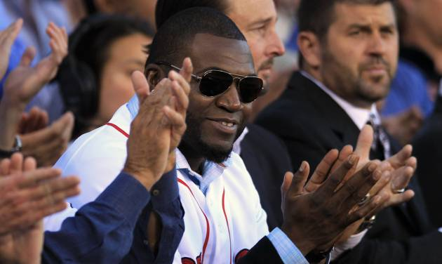 Boston Red Sox's David Ortiz, center front, applauds with former Red Sox players Tim Wakefield, center right, and Jason Varitek, right, during ceremonies held to honor the life of the late Johnny Pesky at Fenway Park, in Boston, Sunday, Sept. 23, 2012. Pesky, who died in August at the age of 92, was a player, manager, and coach for the team. (AP Photo/Steven Senne)