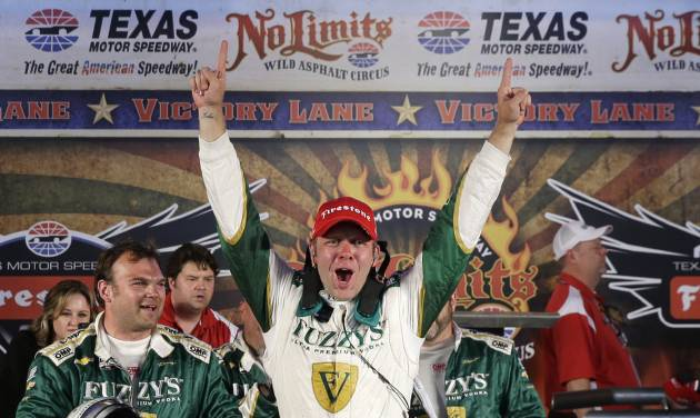 Ed Carpenter celebrates his victory in the IndyCar auto race at Texas Motor Speedway in Fort Worth, Texas, Saturday, June 7, 2014. (AP Photo/Tim Sharp)
