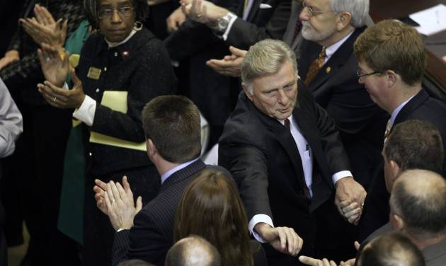 Arkansas Gov. Mike Beebe, center right, is greeted by legislators in the House chamber at the Arkansas state Capitol in Little Rock, Ark., after he delivered his State of the State address Tuesday, Jan. 15, 2013. (AP Photo/Danny Johnston)