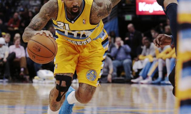 Denver Nuggets forward Wilson Chandler (21) drives past Dallas Mavericks guard Vince Carter  in the third quarter of an NBA game in Denver on Wednesday, March 5, 2014. Chandler had 21 points in Denver's 115-110 victory.(AP Photo/Joe Mahoney)