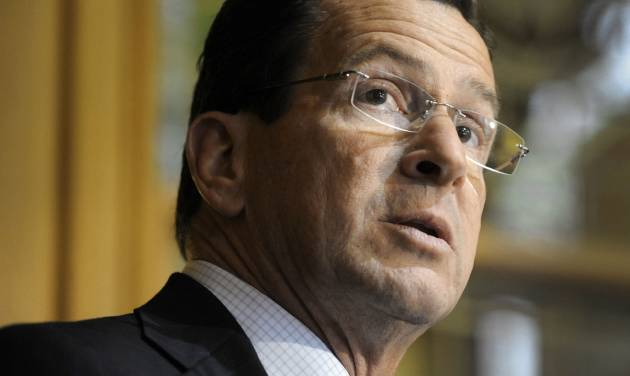 "File-This May 4, 2011, shows Connecticut Gov. Dannel P. Malloy speaking after signing a two-year $40.1 billion budget bill into law at the Capitol in Hartford, Conn.  A federal judge upheld Connecticut's gun control law on Thursday, Jan. 30, 2014, saying the sweeping measure is constitutional even as he acknowledged the Second Amendment rights of gun owners who sued to block it. The law, which Malloy signed last April after months of negotiations in the legislature, was not entirely written ""with the utmost clarity,"" U.S. District Judge Alfred Covello said in his 47-page decision. Still, several provisions are ""not impermissibly vague in all of their applications and, therefore, the challenged portions of the legislation are not unconstitutionally vague."" (AP Photo/Jessica Hill, File)"