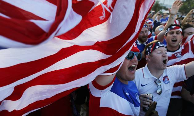 Fans of the U.S. national soccer team gather to cheer before the Group G World Cup match between the United States and Portugal on Copacabana Beach in Rio de Janeiro, Brazil. AP Photo   Leo Correa -