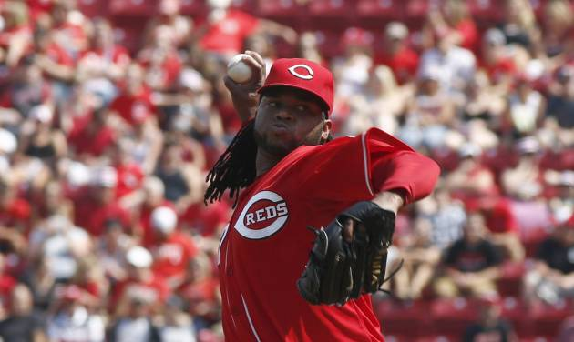 Cincinnati Reds starting pitcher Johnny Cueto throws against the Washington Nationals in the first inning of a baseball game on Saturday, July 26, 2014, in Cincinnati. (AP Photo/David Kohl)