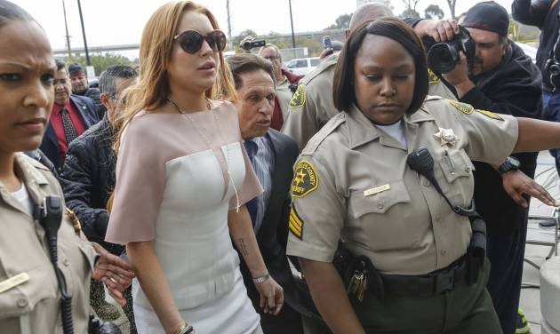 Actress Lindsay Lohan arrives at the Los Angeles Superior court Monday, March 18, 2013. Lohan is charged with three misdemeanor counts stemming from a crash on Pacific Coast Highway. She is charged with willfully resisting, obstructing or delaying an officer, providing false information to an officer and reckless driving. She is also accused of violating her probation in a misdemeanor jewelry theft case. (AP Photo/Damian Dovarganes)