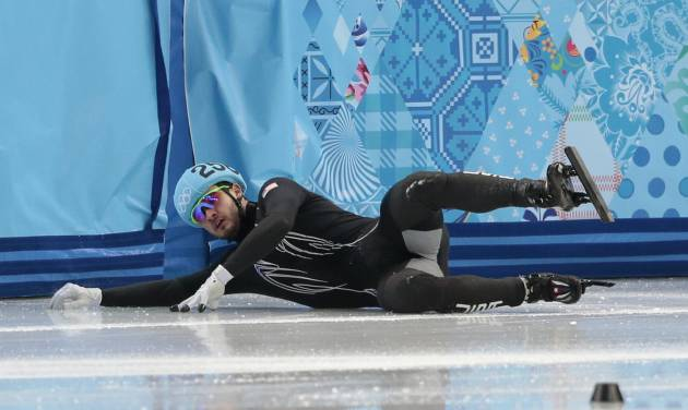 Eduardo Alvarez of the United States crashes out in a men's 500m short track speedskating heat at the Iceberg Skating Palace during the 2014 Winter Olympics, Tuesday, Feb. 18, 2014, in Sochi, Russia. (AP Photo/Ivan Sekretarev)