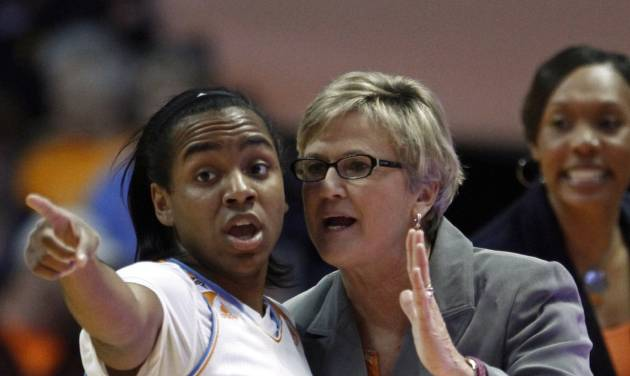 Tennessee coach Holly Warlick talks with guard Ariel Massengale during the first half of an NCAA college basketball game against LSU on Thursday, Jan. 2, 2014, in Knoxville, Tenn. LSU won 80-77. (AP Photo/Wade Payne)