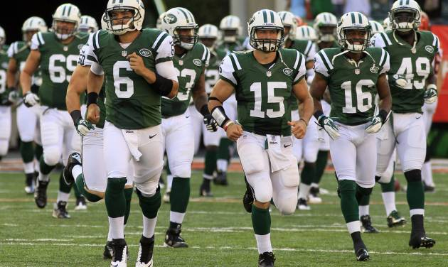 FILE - In this Aug. 10, 2012, file photo, New York Jets quarterback Mark Sanchez (6) leads the team onto the field along with quarterback Tim Tebow (15) for an NFL preseason football game against the Cincinnati Bengals in Cincinnati. After a tumultuous offseason in which he was criticized by fans, media and anonymous New York Jets teammates, Sanchez has done everything he can to make his fourth NFL season special. (AP Photo/Al Behrman, File)