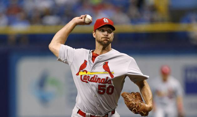 St. Louis Cardinals starting pitcher Adam Wainwright throws during the first inning of a baseball game against the Tampa Bay Rays, Tuesday, June 10, 2014, in St. Petersburg, Fla. (AP Photo/Mike Carlson)