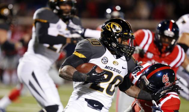 Missouri running back Henry Josey (20) runs through Mississippi defenders for short yards in the second half of an NCAA college football game Saturday, Nov. 23, 2013, in Oxford, Miss. Missouri won 24-10. (AP Photo/Rogelio V. Solis)