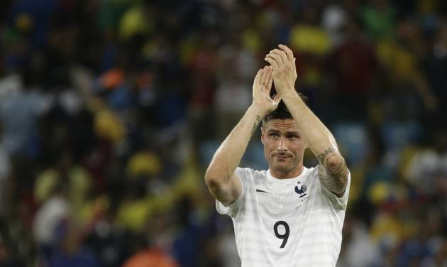 France's Olivier Giroud applauds his supporters after the group E World Cup soccer match between Ecuador and France at the Maracana Stadium in Rio de Janeiro, Brazil, Wednesday, June 25, 2014. France drew 0-0 with 10-man Ecuador to advance to the second round of the World Cup, while the South Americans will be going home from the tournament. (AP Photo/Christophe Ena)