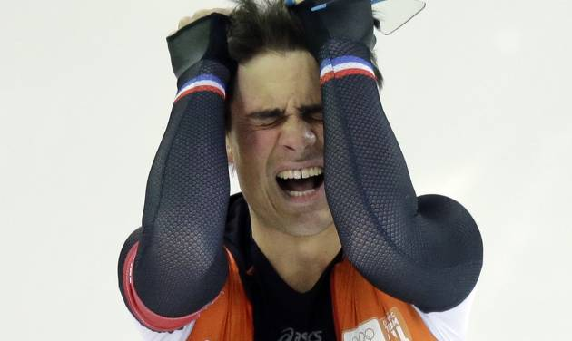 Silver medallist Jan Smeekens of the Netherlands pulls his hair after completing his second heat for the men's 500-meter speedskating race at the Adler Arena Skating Center at the 2014 Winter Olympics, Monday, Feb. 10, 2014, in Sochi, Russia. (AP Photo/David J. Phillip)