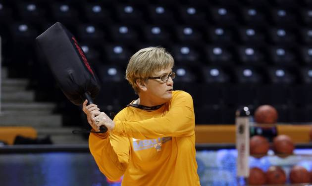 Tennessee head coach Holly Warlick holds a blocking pad as she waits for the next player to drive to the basket during practice for the NCAA women's college basketball tournament Friday, March 21, 2014, in Knoxville, Tenn. Tennessee will face Northwestern State in a first-round playoff game Saturday. (AP Photo/Mark Humphrey)