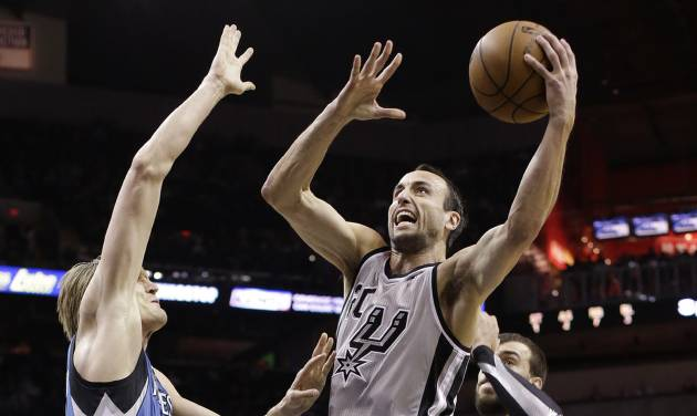 San Antonio Spurs' Manu Ginobili, center, of Argentina, shoots over Minnesota Timberwolves' Andrei Kirilenko, left, of Russia, during the first quarter of an NBA basketball game on Sunday, Jan. 13, 2013, in San Antonio. (AP Photo/Eric Gay)