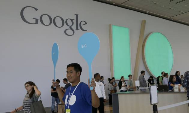 A Google employee helps direct people as they register for Google I/O 2014 in San Francisco, Tuesday, June 24, 2014. (AP Photo/Jeff Chiu)