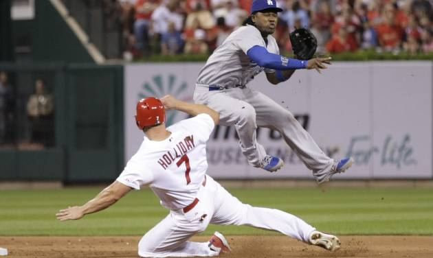 Los Angeles Dodgers shortstop Hanley Ramirez (13) leaps over a sliding St. Louis Cardinals' Matt Holliday (7) in the fourth inning of a baseball game, Sunday, July 20, 2014 in St. Louis.  (AP Photo/Tom Gannam)