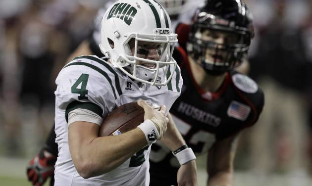 Ohio quarterback Tyler Tettleton (4) breaks away from Northern Illinois linebacker Pat Schiller for an 18-yard touchdown during the second quarter of an NCAA college football game in Detroit, Friday, Dec. 2, 2011. (AP Photo/Carlos Osorio) ORG XMIT: MICO101
