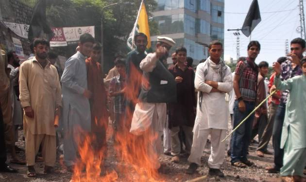 Pakistani Kashmiris burn an Indian flag during an anti-Indian rally in Muzaffarabad, capital of Pakistani Kashmir, Thursday, Aug. 15, 2013. India's prime minister on Thursday asked Pakistan to prevent Islamic militants from using its territory as tensions rise between the longtime rivals following the recent killing of five Indian soldiers in fighting along the disputed Kashmir border. (AP Photo/M.D. Mughal)