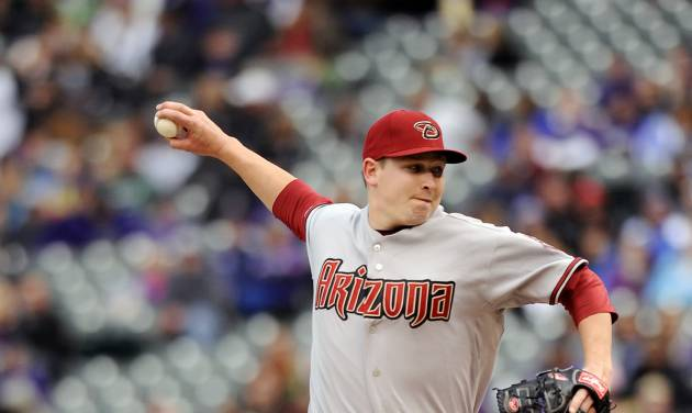 Arizona Diamondbacks starting pitcher Trevor Cahill throws in the first inning of a baseball game against the Colorado Rockies on Sunday, April 15, 2012 in Denver. (AP Photo/Chris Schneider)
