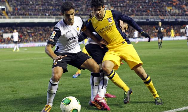Atletico de Madrid's  Diego Costa, right,  duels for the ball with Valencia's  Ricardo Costa from Portugal  during their la Copa del Rey soccer match at the Mestalla stadium in Valencia, Spain, Tuesday, Jan. 7, 2014. (AP Photo/Alberto Saiz)