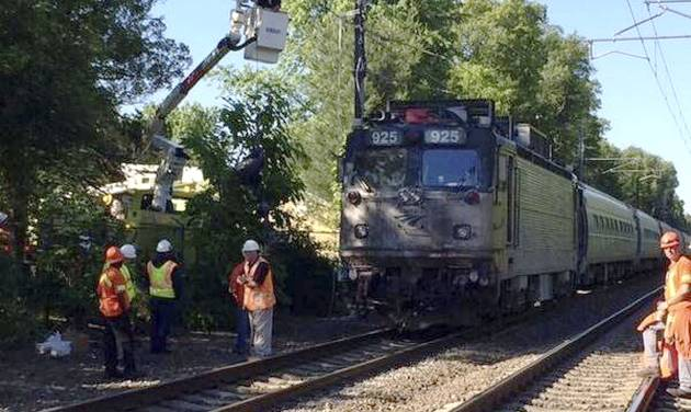 In this photo provided by the Massachusetts Bay Transportation Authority Transit Police via Twitter, officials work at the scene Monday, June 23, 2014, where an Amtrak train struck a vehicle overnight in Mansfield, Mass. Three people in the vehicle were killed. Service on Amtrak and MBTA lines was delayed while the crash was investigated. (AP Photo/Massachusetts Bay Transportation Authority Transit Police)
