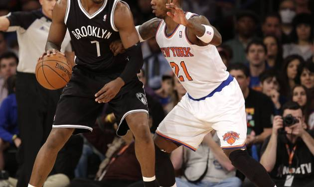 New York Knicks' Iman Shumpert, right, guards Brooklyn Nets' Joe Johnson during the first half of the NBA basketball game at Madison Square Garden, Monday, Jan. 20, 2014, in New York. (AP Photo/Seth Wenig)
