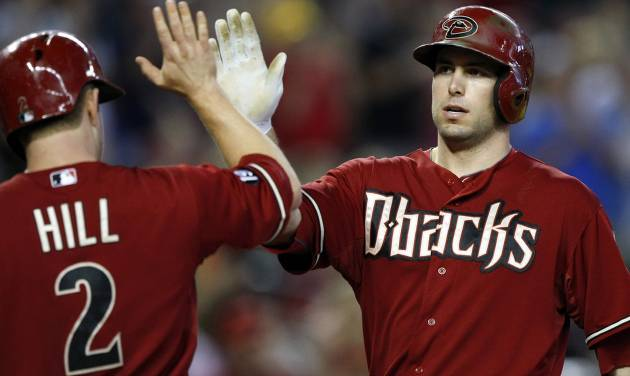 Arizona Diamondbacks' Paul Goldschmidt, right, celebrates with teammate Aaron Hill (2) in the third inning after hitting a two-run home run during a baseball game against the Colorado Rockies, Sunday, Sept. 15, 2013, in Phoenix. (AP Photo/Rick Scuteri)