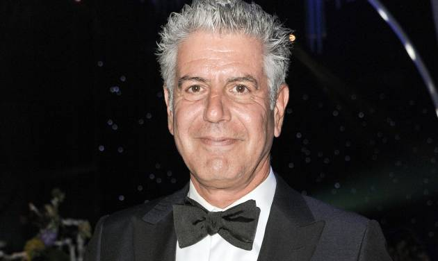 FILE - This Sept. 15, 2013 file photo shows Anthony Bourdain at the 2013 Primetime Creative Arts Emmy Awards Governors Ball in Los Angeles. Bourdain, Ina Garten, and Martha Stewart remain the names to beat in food broadcasting. For a second year running, the three dominated the top tier of television awards by the James Beard Foundation, winning for the same shows in the same categories as in 2014.  (Photo by Richard Shotwell/Invision/AP, File)