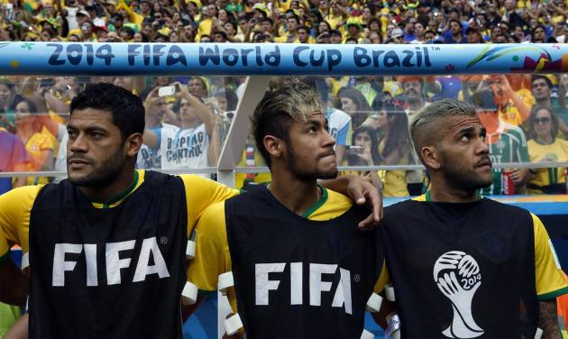 From left, Brazil's Hulk, Neymar and Dani Alves wait for the start of the World Cup third-place soccer match between Brazil and the Netherlands at the Estadio Nacional in Brasilia, Brazil, Saturday, July 12, 2014. (AP Photo/Andre Penner)