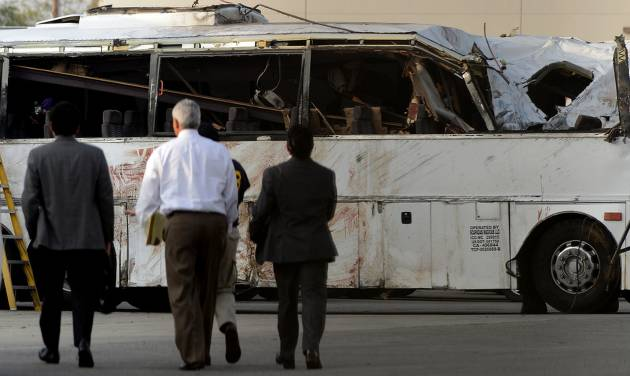 National Transportation Safety Board members walk toward the bus crash site Tuesday, Feb. 5, 2013, in Ontario, Calif., before giving an update on the investigation of Sunday's tour bus crash near Yucaipa that killed seven people.(AP Photo/.Inland Valley Daily Bulletin, Jennifer Cappuccio Maher)