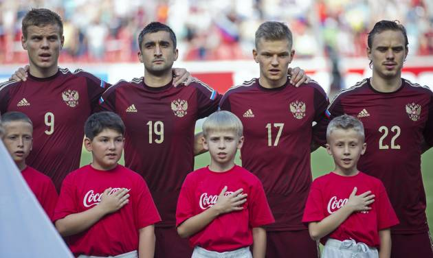 Top row from left Russia's national soccer team players Alexander Kokorin, Alexander Samedov, Oleg Shatov and Andrey Eshenko listen to Russia's national anthem before a friendly soccer match against Morocco in Moscow, Russia, Friday, June 6, 2014. Russia won 2-0. This is the last friendly match before the Russian team leave for Brazil to compete in the World Cup. (AP Photo/Pavel Golovkin)