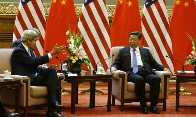 U.S. Secretary of State John Kerry meets with China's President Xi Jinping, right, at the Great Hall of the People in Beijing Thursday, July 10, 2014. (AP Photo/Jim Bourg, Pool)