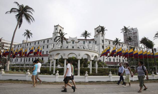 People walk past Hotel El Caribe in Cartagena, Colombia, Saturday April 14, 2012. The Secret Service sent home some of its agents for misconduct that occurred at the hotel before President Barack Obama's arrival on Friday for the Summit of the Americas. (AP Photo/Fernando Vergara)