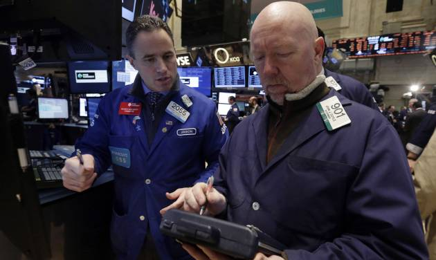 FILE - In this Wednesday, Jan. 8, 2014, file photo, specialist Jason Hardzewicz, left, and trader John Doyle work on the floor of the New York Stock Exchange. Stock indexes are slightly higher in early trading Friday, Jan. 10, 2014. (AP Photo/Richard Drew, File)
