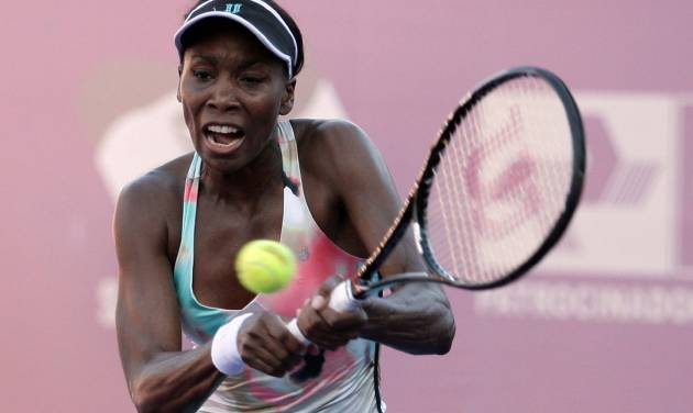 In this photo released by Foto Arena, U.S. tennis player Venus Williams returns the ball to Russia's Olga Puchkova during a WTA Brasil Tennis Cup semifinal game in Florianopolis, Brazil, Friday, March 1, 2013.  Puchkova won 2-1. (AP Photo/Cristiano Andujar, Foto Arena)