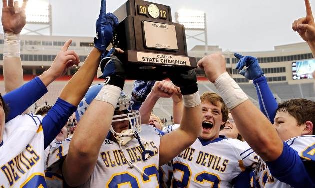 Ringling players celebrate with the championship trophy. #33 is Allen Patrick. #23 is Joe Hill. Ringling Blue Devils defeated Wynnewood, Savages 39-12  in the  Class A High School football championship game at Boone Pickens Stadium in Stillwater on Saturday,  Dec. 8, 2012.  Photo by Jim Beckel, The Oklahoman