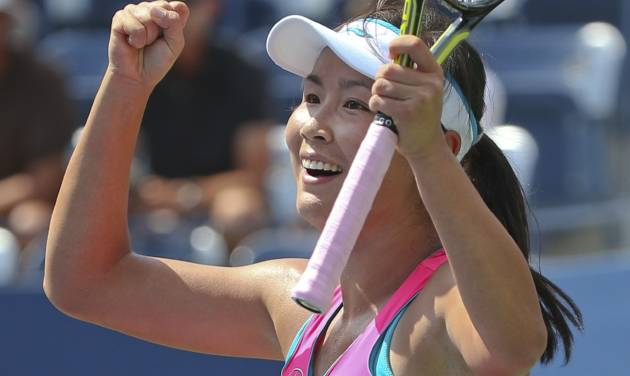 Peng Shuai, of China, reacts after defeating Belinda Bencic, of Switzerland, during the quarterfinals of the 2014 U.S. Open tennis tournament, Tuesday, Sept. 2, 2014, in New York. (AP Photo/Mike Groll)