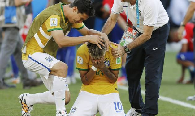 Brazil's Neymar reacts after the penalty shootout at the World Cup round of 16 soccer match between Brazil and Chile at Mineirao Stadium in Belo Horizonte, Brazil, Saturday, June 28, 2014. Brazil won 3-2 on penalties after Neymar scored the winner in the shootout. (AP Photo/Frank Augstein)