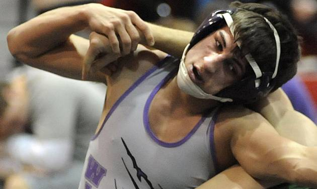 This Jan. 16, 2014, photo shows Keystone High School wrestler Logan Stiner during a match in Sheffield Village, Ohio. The Food and Drug Administration is warning consumers to avoid pure powdered caffeine sold on the Internet after Stiner died after consuming it. Even a teaspoon of the powder could be lethal — it is equivalent to 25 cups of coffee. (AP Photo/Steve Manheim, The Chronicle Telegram)