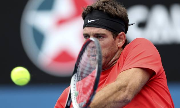 Juan Martin del Potro of Argentina plays a backhand shot in his match against Nicolas Mahut of France during the Sydney International Tennis Tournament in Sydney, Australia, Wednesday, Jan. 8, 2014. (AP Photo/Rob Griffith)