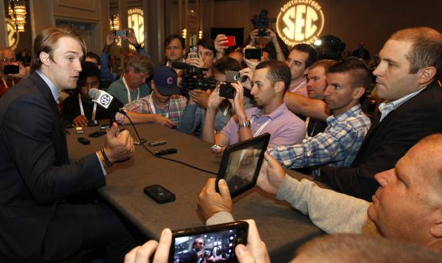 Mississippi quarterback Bo Wallace, left, speaks to the media at the Southeastern Conference NCAA college football media days, Thursday, July 17, 2014, in Hoover, Ala. (AP Photo/Butch Dill)