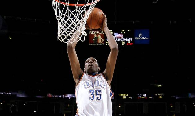 Oklahoma City's Kevin Durant dunks the ball past Rasual Butler, left, James Posey, and Julian Wright of New Orleans during the NBA basketball game between the Oklahoma City Thunder and the New Orleans Hornets at the Ford Center in Oklahoma City on Friday, Nov. 21, 2008.   BY BRYAN TERRY, THE OKLAHOMAN
